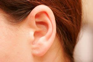 Painless Lump Behind Ear: 3 Common Types, Symptoms, and