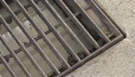 How to Install an Outside Garage Floor Drain | Garden Guides