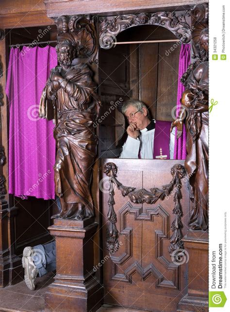 Sinner And Priest In Confession Booth Stock Photo - Image