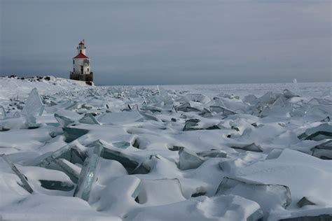 The Superior Wisconsin harbor entry lighthouse and frozen