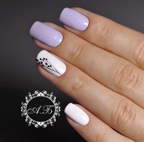 Use a dotting tool and slender nail brush to create this